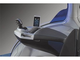 The integrated armrest is an exercise in minimalism with ergonomic joystick and smartphone control