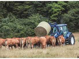 The methane powered concept tractor can be fitted with a loader, here feeding cattle