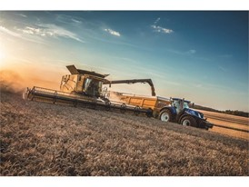 New Holland CR Revelation combine working with a New Holland Tractor in the field