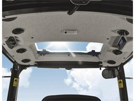 An opening roof panel offers additional sightline when working with a raised front-end loader