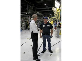 U.S. Senator Jerry Moran speaks with a CNH Industrial plant employee in Wichita, Kansas facility