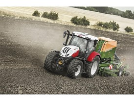 Steyr Profi 4145 CVT Seeder Combination working in a field
