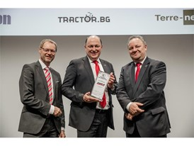 Case IH Brand President Andreas Klauser(center) receiving Machine of the Year for Case IH