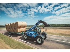 New Holland LM7.42 Telehandler transporting bales