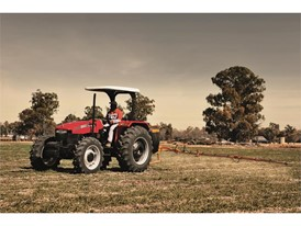 Case IH JXT working with a sprayer