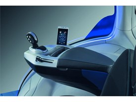 The armrest is an exercise in agricultural minimalism and the smartphone is the link between the tractor and the office