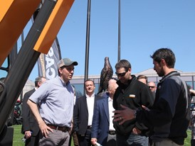Wisconsin Governor Scott Walker discusses equipment to be used at the Foxconn development with Ed Brenton and Eric Ziese