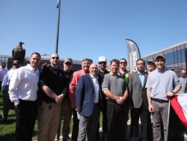 Wisconsin Governor Scott Walker and CNH Industrial VP Scott Harris pose with other contractors and suppliers