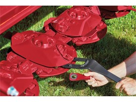 Change knives on Case IH DC3 series disc mower conditioner headers in one-third the time of standard knife system