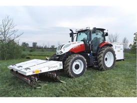 A STEYR tractor using XPower: zero-chemical weed control, through the use of electro-herbicide technology