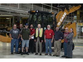U.S. Senator Chuck Grassley surrounded by employees at the CASE Construction Equipment Burlington Plant