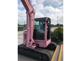 CASE excavator blushes to raise money for breast cancer charity