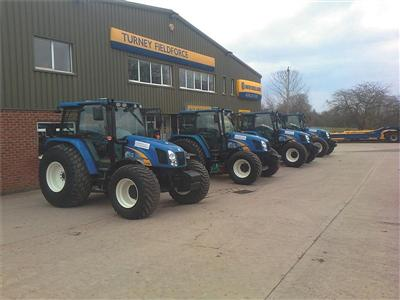 New Holland tractors rolling off forecourt after two prestigious deals