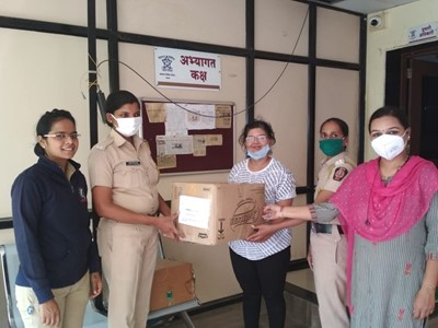 Dropping off donation of sanitary supplies at the Pune Chakan police station