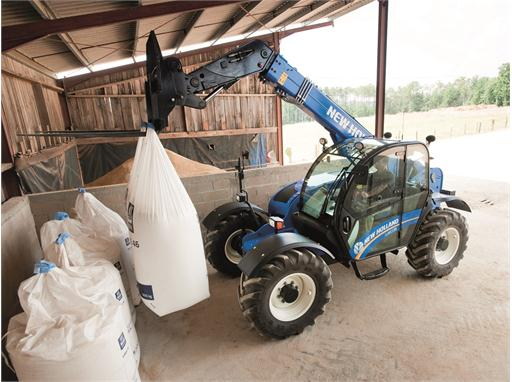 New Holland LM7.35 Telehandler moving fertilizer bags