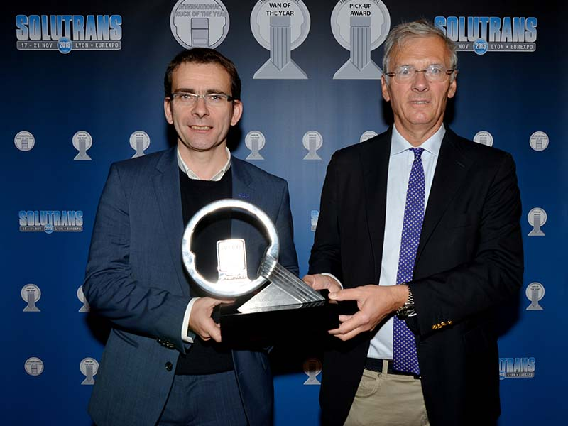 Iveco Brand President Pierre Lahutte (left) accepts Truck of the Year 2016 award from jury Chairman Gianenrico Griffini