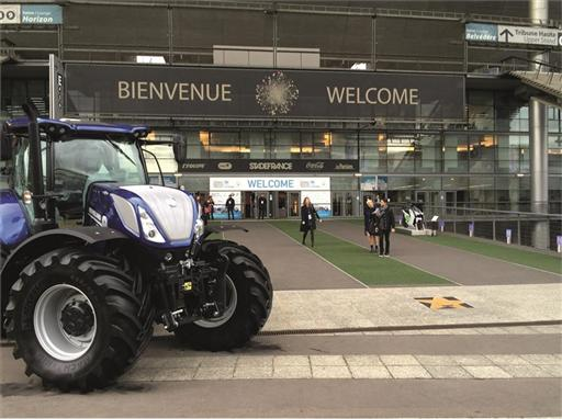 A New Holland Agriculture T7 tractor displayed outside COP 21 grounds