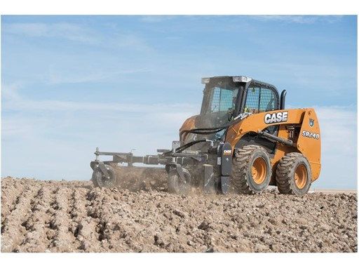 A Case Skid Steer Loader working on tilled soil