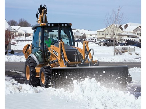 CASE 590 SN Backhoe Loader conducting snow removal