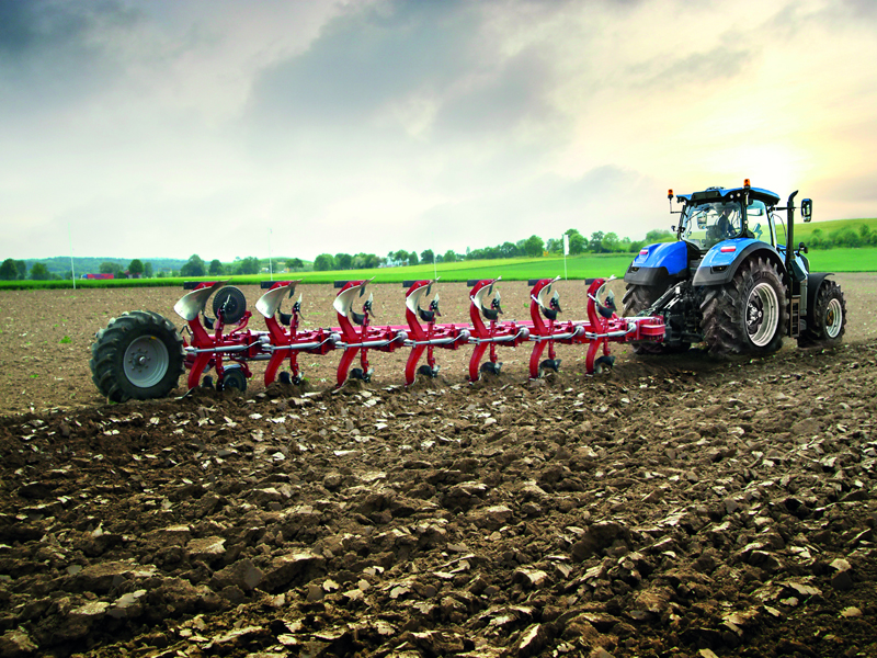A New Holland tractor working with a plough