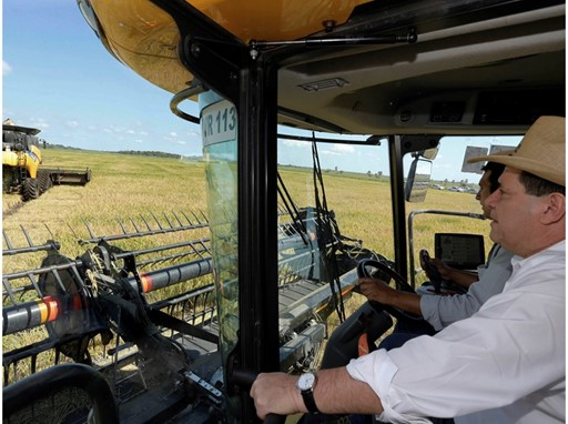 The President of Paraguay in the cab of a New Holland combine harvester,  photo courtesy of René González