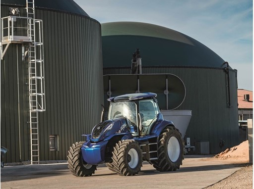 The methane powered concept tractor in front of the biodigesters