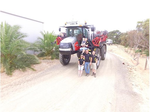 The Krieg family with their hardworking, special anniversary Patriot sprayer.