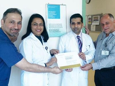 The SKGH laboratory management team (from left to right): Jameel Abulaban, BSc, MSc; Divya Tripathi, MD, MBBS; Mubarak A