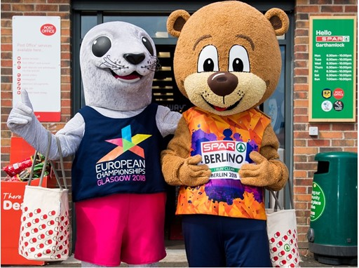 Glasgow 2018 mascot and Berlin 2018 mascot Berlino go shopping at SPAR