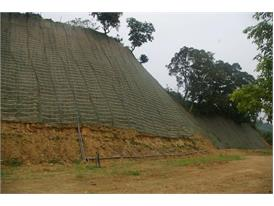 Nonwoven water and soil conservation net on the slope
