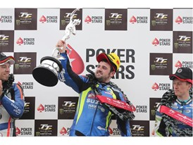 Michael Dunlop lifts the Senior TT Trophy