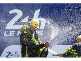 Aston Martin's Jonny Adam celebrates LMGTE Pro success