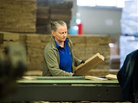 Opris Maria sorts wooden bricks at Aviva