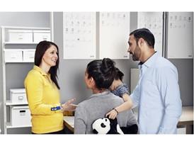 IKEA co-worker helping costumers