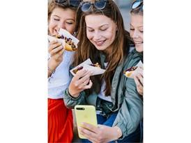 People eating the IKEA veggie hot dog