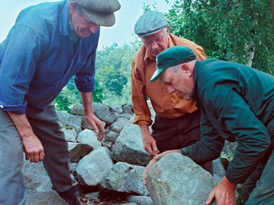 Men building a stone wall