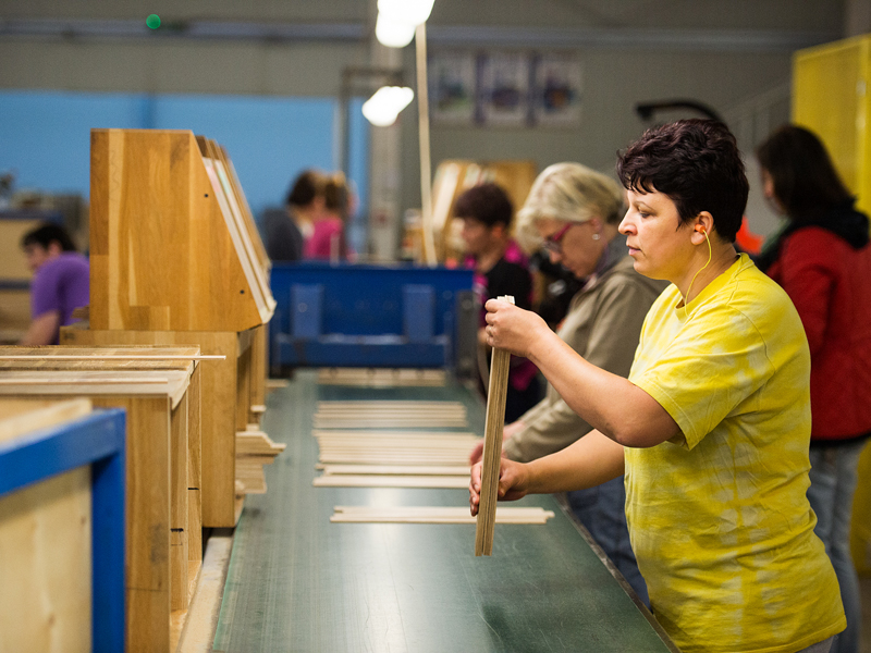 Tupisca Mariana is checking the quality of lamellas sorts wooden bricks at Aviva