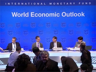 IMF Sees Higher Growth, Warns of Risks