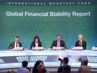 IMF: Financial Stability Improves, but Risks Remain