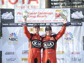 Kia Racing drivers Nic Jonsson and Mark Wilkins celebrate a double-podium finish on the Streets of Long Beach.
