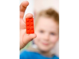 Red Brick Held by Child
