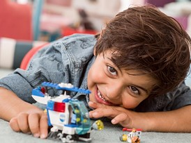 Boy Playing with LEGO Junior