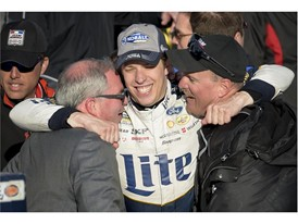 Brad Keselowski celebrates win