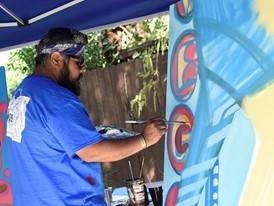 Zappos' resident artist Miguel creates live art masterpiece at the #WHHSH Las Vegas Party in Palm Springs
