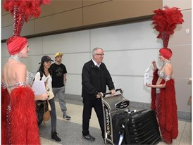 Showgirls greet Norwegian passengers