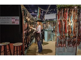 Cowgirl checks out the halters and headstalls