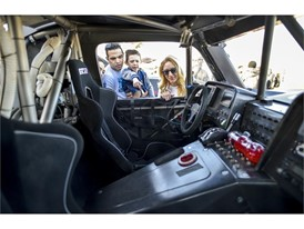 A family checks out the interior of one of the racers in Las Vegas as the Mint 400 4 Wheel Parts Vehicle Procession