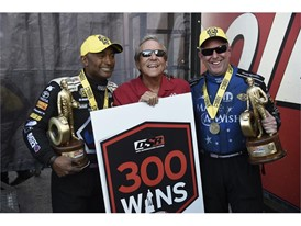 Antron Brown, Tommy Johnson Jr. with Don Schumacher (center)