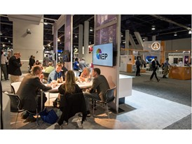 Salespeople meet in the NEP broadcast technology booth