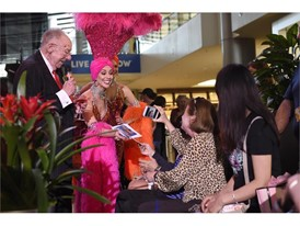 Las Vegas Host Committee Chairman Oscar B. Goodman and showgirls